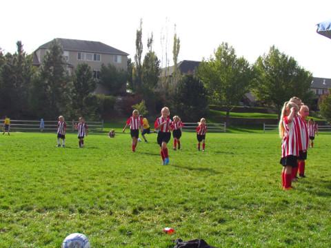 As meninas americanas jogando futebol